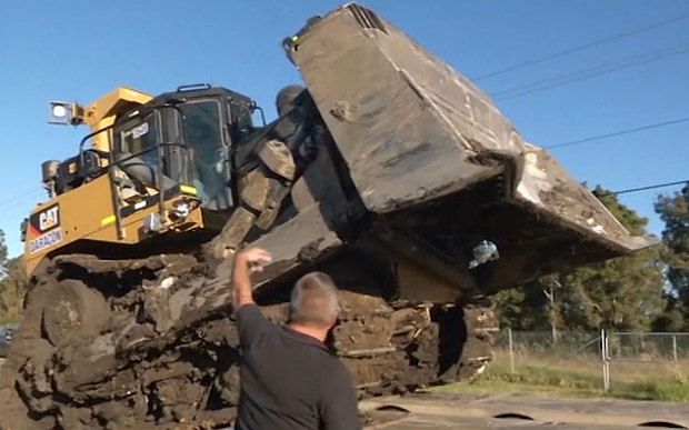 Man On Bulldozer : Man charged with attempted murder after going on bulldozer