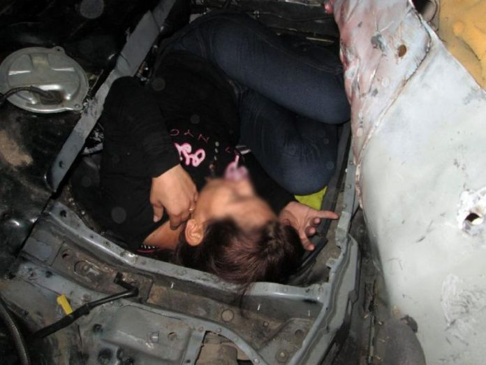 border officers found a woman hidden under the rear seat of a car driven by another - Hidden Pictures For 3 Year Olds