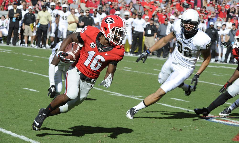 UGA wide receiver Isaiah McKenzie has been accused of making terroristic 'threats or acts' stemming from an incident with a woman at a Chili's restaurant Monday night.