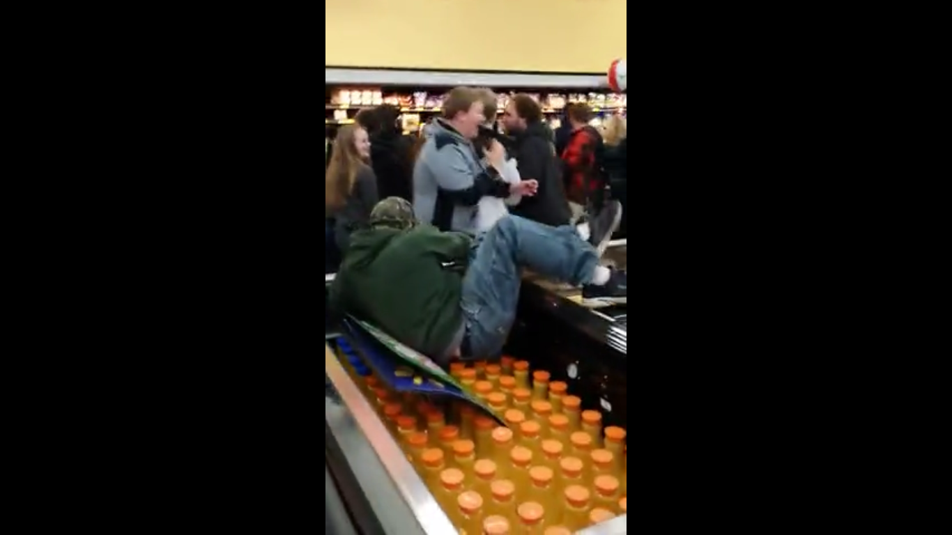 While doing some Black Friday shopping, 'Cooloops0509' managed to capture this insane footage of a young man climbing over an isle of refrigerated goods in order to get to the other side, while utter chaos ensues in the background. Looks like it's shaping up to be another hectic Black Friday this year!