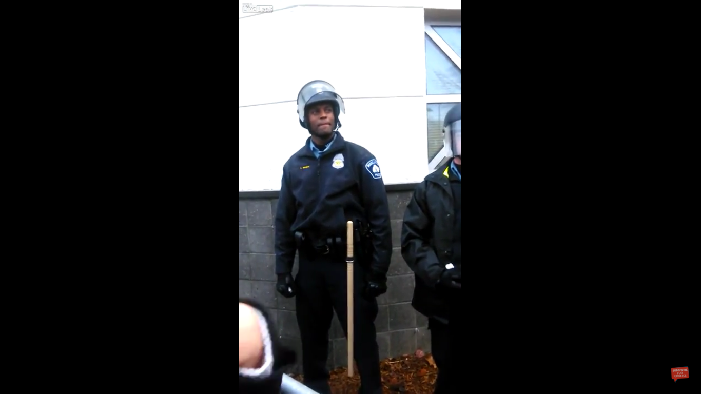 A Black Lives Matter protester was caught on camera yelling insults at a black Minneapolis police officer.