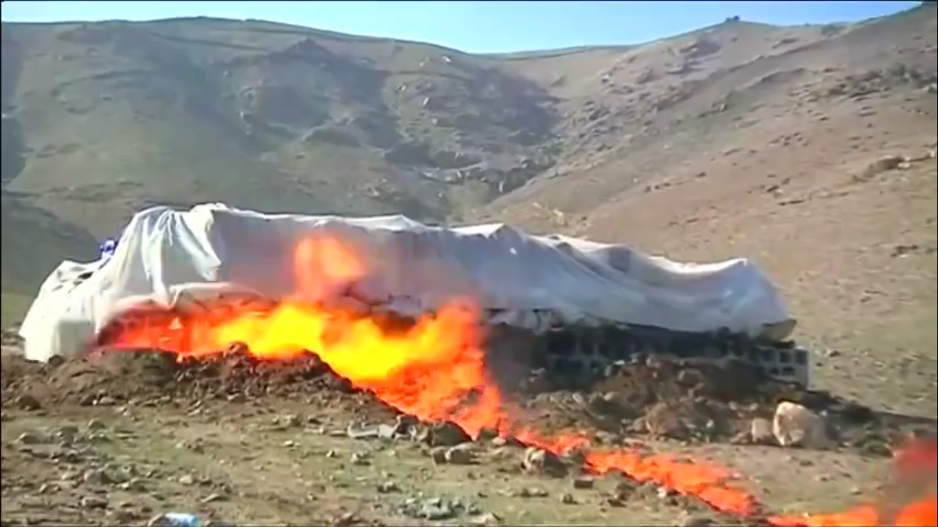 Afghan officials incinerate more than 18 tonnes of drugs confiscated in Kabul. Rough Cut (no reporter narration).