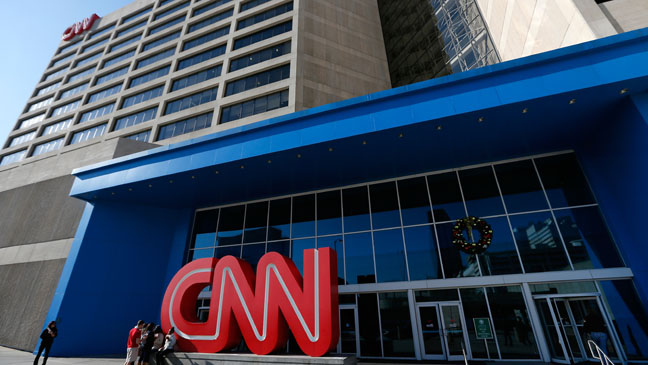 ATLANTA, GA - NOVEMBER 29:  People sit outside of the CNN Center on November 29, 2012 in Atlanta, Georgia. CNN announced that is has named former NBC Universal chief Jeff Zucker as its new top executive.  (Photo by Kevin C. Cox/Getty Images)