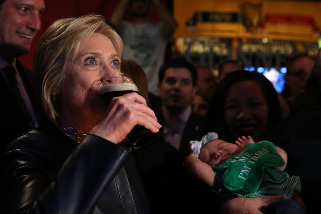 intensely-drinking-a-beer-hillary-640x427