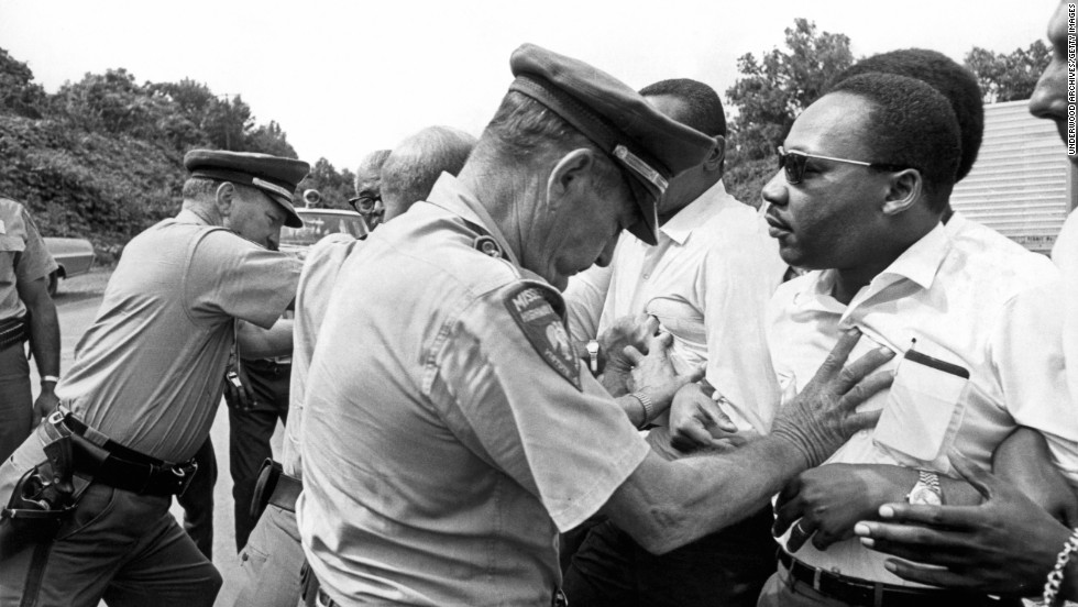 """Martin Luther King being shoved back by Mississippi patrolmen during the 220 mile """"March Against Fear"""" from Memphis, Tennessee to Jackson, Mississippi.  Mississippi:  June 8, 1966.  (Photo by Underwood Archives/Getty Images)"""